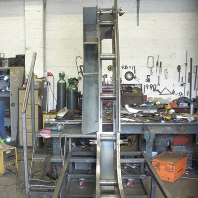 Frame of a custom swarf conveyor